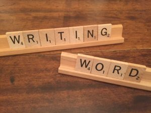 scrabble tiles that spell writing word